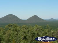 View of the Glasshouse Mountains . . . CLICK TO ENLARGE