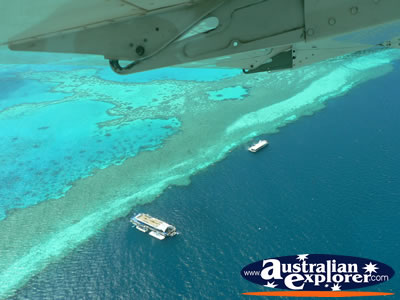 Seaplane over Heart Reef . . . CLICK TO VIEW ALL WHITSUNDAYS (HEART REEF) POSTCARDS